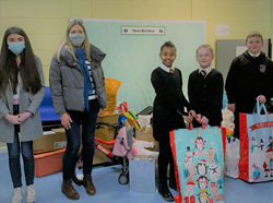 School children receive gifts from Stars staff following company-wide Christmas appeal