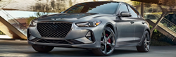 Gray 2021 Genesis G70 Front Exterior in a Driveway