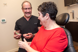 Dentist, Dr. Robert Leedy and a Dental Implant Patient in Abilene, TX