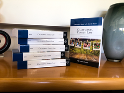 """A stack of books with the spines face forward with the title of """"California Family Law,"""" one book to the right of the stack faces forward where you can see the cover of California Family Law. The cover of the textbook includes diverse families."""