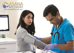 Asana Recovery nurse monitors patient and takes blood pressure for addiction treatment